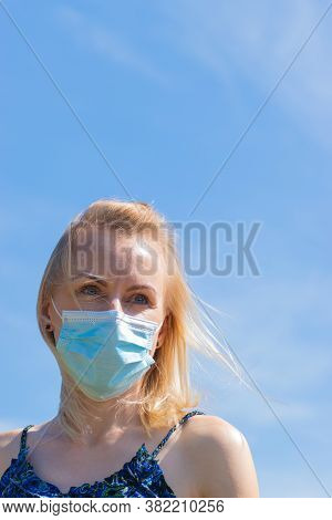 Healthcare And Medicine Concept. Portrait Of Blonde Woman With Windswept Hair And Medicine Mask On H