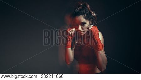 Pretty Female Fighter In Boxing Bandages Trains In Studio In Neon Light. Mixed Martial Arts Poster.