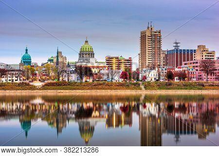 Harrisburg, Pennsylvania, USA skyline on the Susquehanna River at dusk.