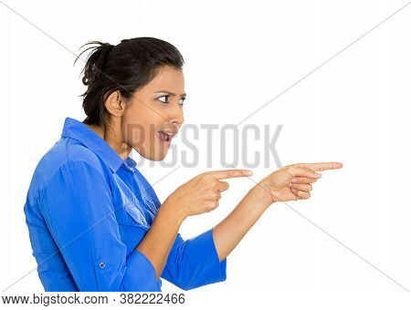 Side Profile Portrait Of Young Unhappy, Serious Woman Pointing At Someone With Fingers Blaming Isola