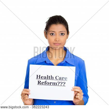 Portrait Of A Skeptical Woman Holding A Sign Health Care Reform