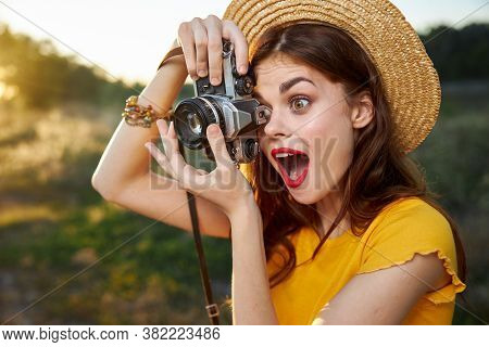 Woman Photographer Looks Into The Camera Lens With Open Mouth Surprised Look Nature