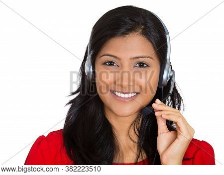 Portrait Of A Smiling Female Customer Representative With Phone Headset Isolated On White Background