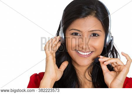 Portrait Of A Smiling Female Customer Representative With Phone Headset