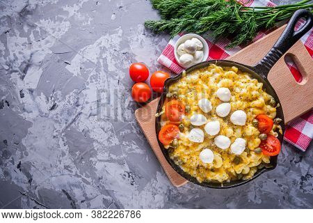 Delicious Pasta And Cheese Casserole In A Cast Iron Skillet