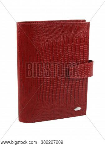 New Red Wallet Of Genuine Reptile Skin Leather. Without Shadows. Isolated On White Background. Close