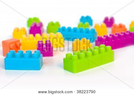 Colorful lego blocks over a white background poster