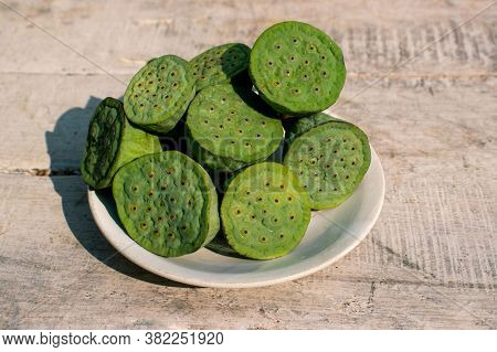 Indian Lotus Pod Or Nelumbo Nucifera Pods In A Plate On Wooden Surface