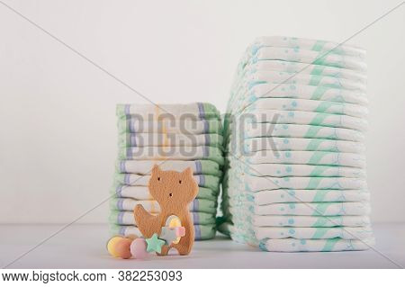Baby Diapers On A White Background Close-up And Copy Space. Accessories For A Newborn Diapers, Pacif