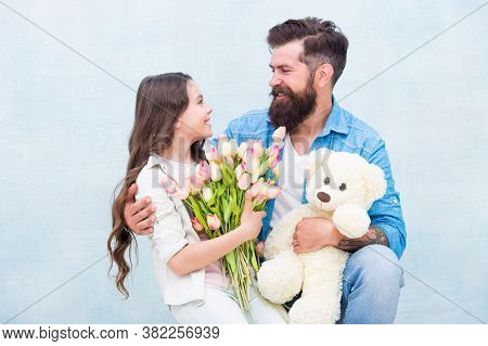 One Adoption Is Enough To Change Lives. Adoptive Family. Bearded Man And Little Girl Hold Flowers An