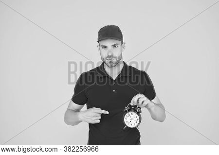 Countdown. Deadline And Discipline. Punctual Delivery Man. On-time Delivery. Man In Uniform Pointing