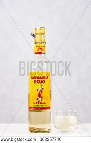 Prague, Czech Republic - October 19, 2019. Bottle Of Gusano Rojo Mezcal With Shot On Light Backgroun