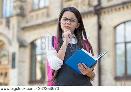 Imagine Your Dreams. Little Kid Hold Book With Thoughtful Look. Imaginative Thinking. School Time. C