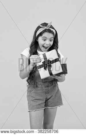 Surprised Kid On Yellow Background. Birthday Surprise For Her. Bargain Sale Concept. Black Friday Di