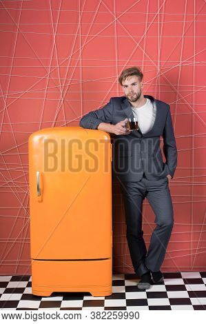 Man Formal Elegant Suit Lean On Retro Vintage Yellow Refrigerator. Bachelor Elegant Guy Drink Tea Or