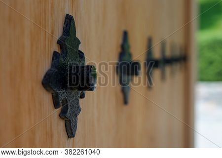Selective Focus To Decorative Black Metal Rivet On Blurred Surface Of Traditional Japanese Wooden Do
