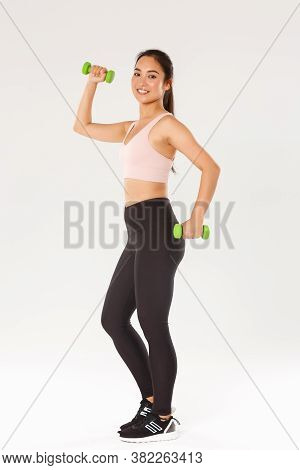Sport, Gym And Healthy Body Concept. Full Length Of Smiling Female Athlete, Cute Girl Doing Fitness