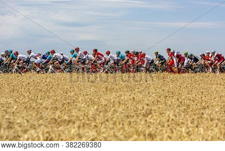 Vendeuvre-sur-barse, France - 6 July, 2017: A Cyclist's Water-can Flies Over The Peloton Passing Thr
