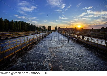 Modern Wastewater Treatment Plant. Tanks For Aeration And Biological Purification Of Sewage At Sunse