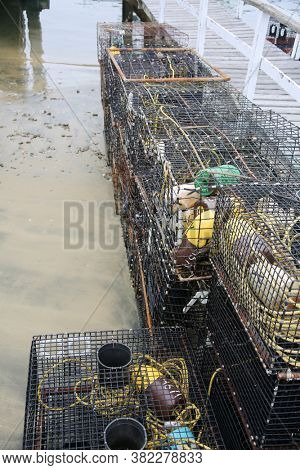 Crab Traps. Fishing Crab Traps stacked and loaded ready to be set out at sea to catch crabs and shell fish.