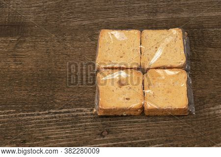 Tasty Rusks On Wooden Background. Packaged With Copy Space