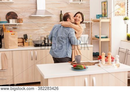 Man Kissing Wife In Kitchen During Romantic Dance In Kitchen. Wife And Husband Love, Romance, Tender