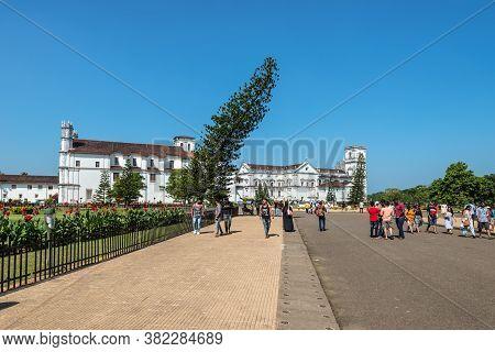 Old Goa, India - November 23, 2019: Tourists And Locals In Front Of The Catholic Church Of St. Franc