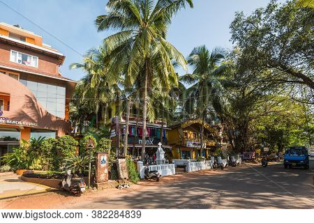 Candolim, North Goa, India - November 23, 2019: Street View Of Goa At Sunny Day With Parked Bikes Ne