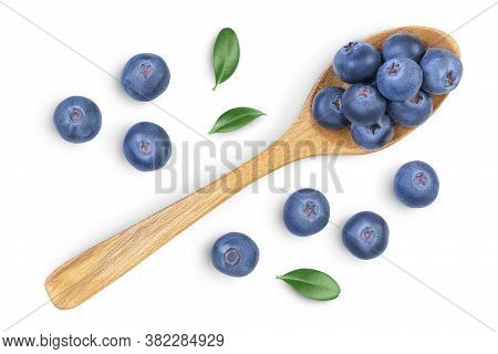 Fresh Ripe Blueberry In Wooden Spoon Isolated On White Background With Clipping Path . Top View. Fla