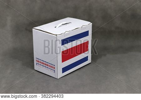 Costa Rica Flag On White Box With Barcode And The Color Of Nation Flag, Paper Packaging For Put Prod