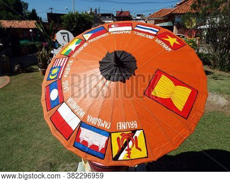 Bor Sang, Chiang Mai, Thailand, December 22, 2018: Parasol With The Flags Of The Countries That Make