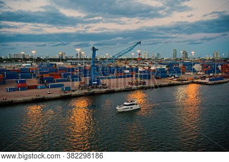 Miami, Usa - March 01, 2016: Sea Port At Dusk. Commercial Terminal. Containers On Pier With Freight
