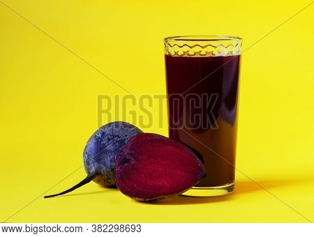 Beet Juice. Fresh Beetroot In A Glass On A Yellow Background. Close Up. Healthy Drink. Fresh-squeeze