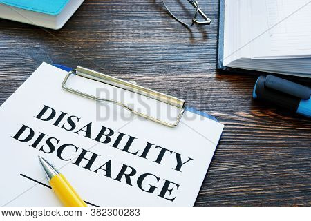 Disability Discharge Application Papers And Pen With Glasses.