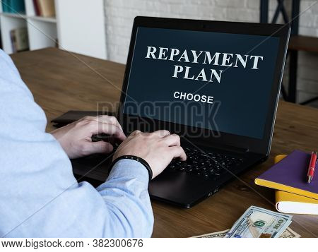 The Man Reads About Loan Repayment Plan And Chooses One.