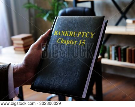 A Lawyer Shows A Book On Bankruptcy Chapter 15.