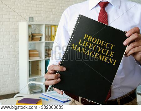 Manager Shows Product Lifecycle Management Plm Book.