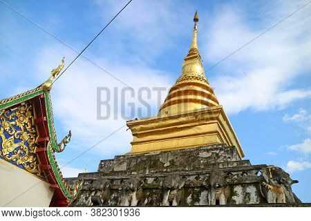 The Upper Part Of Wat Phra That Chang Kham Worawihan Temple's Viharn And Main Chedi In Nan Province,