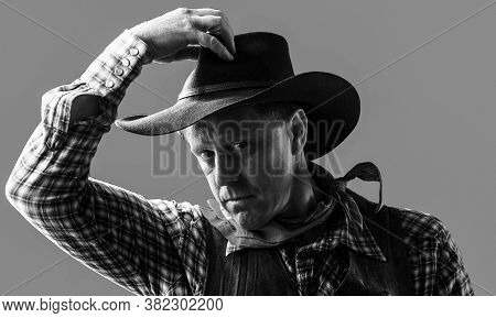 Portrait Of A Cowboy. West, Guns. Portrait Of A Cowboy. Portrait Of Farmer Or Cowboy In Hat. America