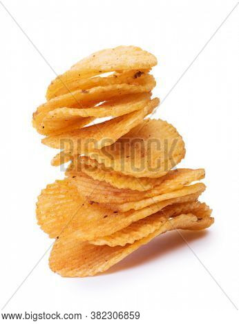 Pile of potato chips fluted isolated on a white background, close-up corrugated crisps