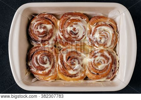 Prepared Cakes Frosting Baked Milk And Butter Top View Photo. Bakehouse Fresh Pastry Rolled Cinnamon