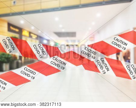 Red And White Warning Caution Tape Covid-19 Warning In Shopping Mall. Department Store Interior With