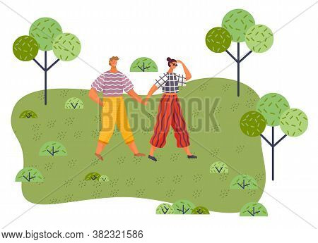 Young Guy And Girl Holding Hands Walking In Summer Garden, Weekend Walk. Friends Man And Woman Met O