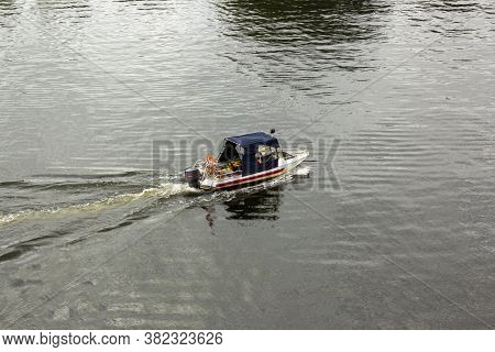 General Plan Of The Outboard Motorboat Sails On The River, The Cabin Of The Boat Is Covered With Awn