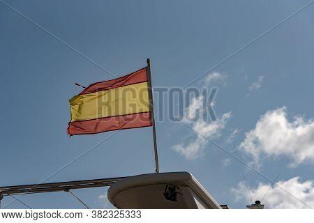 Sant Antoni De Portmany, Ibiza, Spain : Nov 8 2019 : Flag Spain Sunny Day In The Port Of Sant Antoni