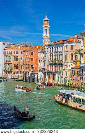 Venice, Italy, September 13, 2019: Gondolier On Gondola Traditional Boat, Vaporetto And Yacht Sailin