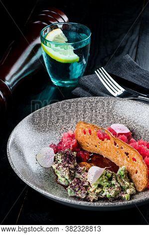 Tuna Tartare Tartar With Avocado. Gourmet Presentation With Culinary Ring On Plate. Tuna And Avocado