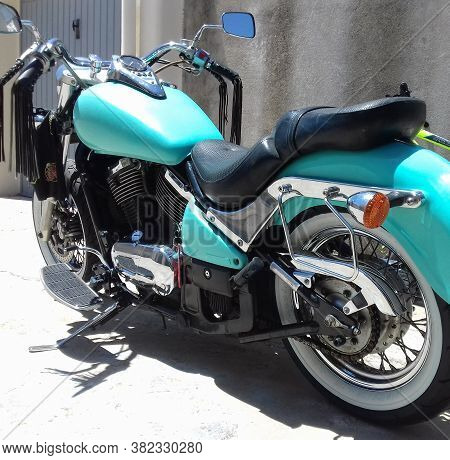 Sardinia, Ita - June 16, 2019: Turquoise Kawasaki Vn 800 Classic With White Wall Tires Parked By A G