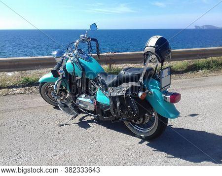 Sardinia, Ita - November 14, 2020: Turquoise Kawasaki Vn 800 Parked By The Sea On A Sunny Day
