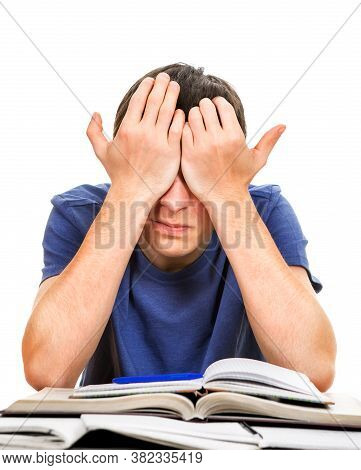 Tired Young Man Rub His Eyes On The School Desk Isolated On The White Background